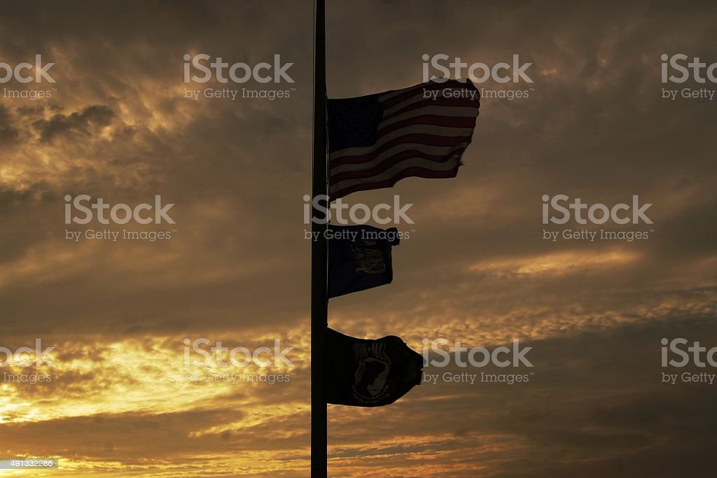 Flags at sunset stock photo