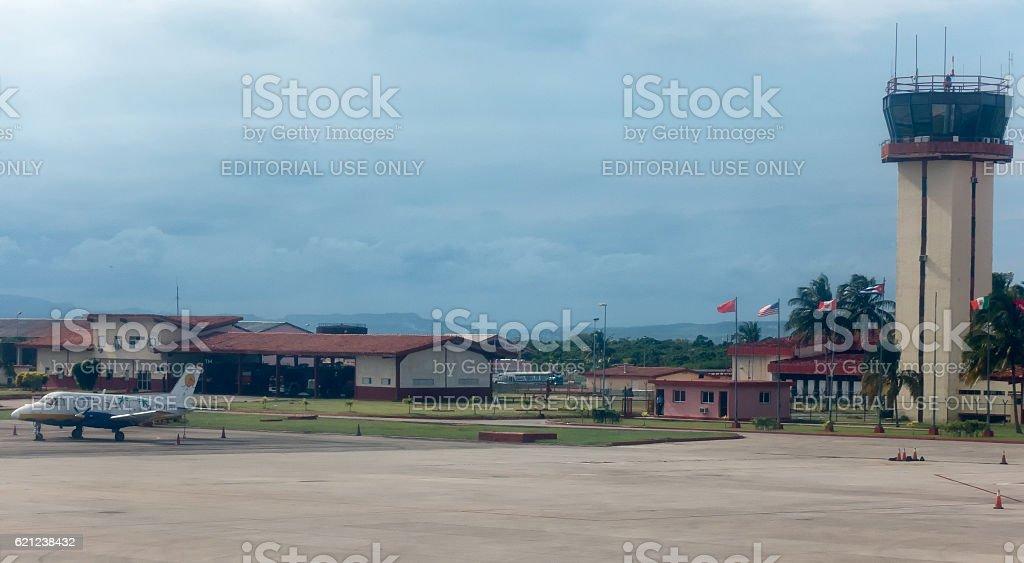 Flags at Veradero Airport in Cuba stock photo