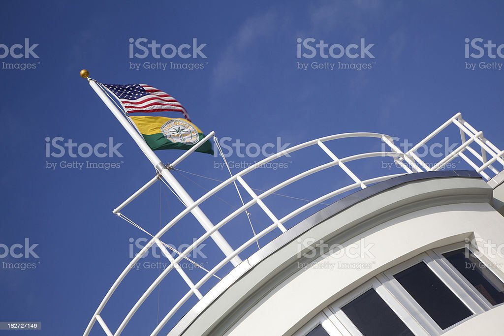 Flags Atop Nautical Themed Building, Miami Beach, Florida royalty-free stock photo