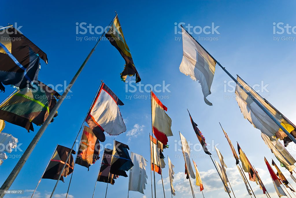 Flags blowing in the wind stock photo