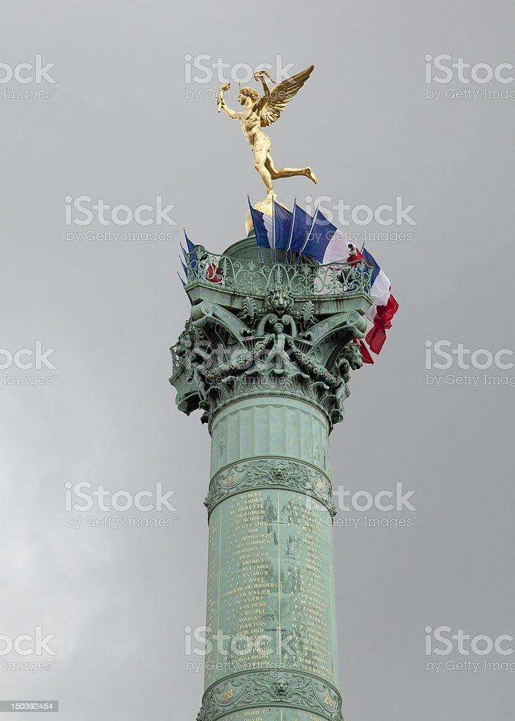 Flags decorate the July Tower at Place de la Bastille stock photo