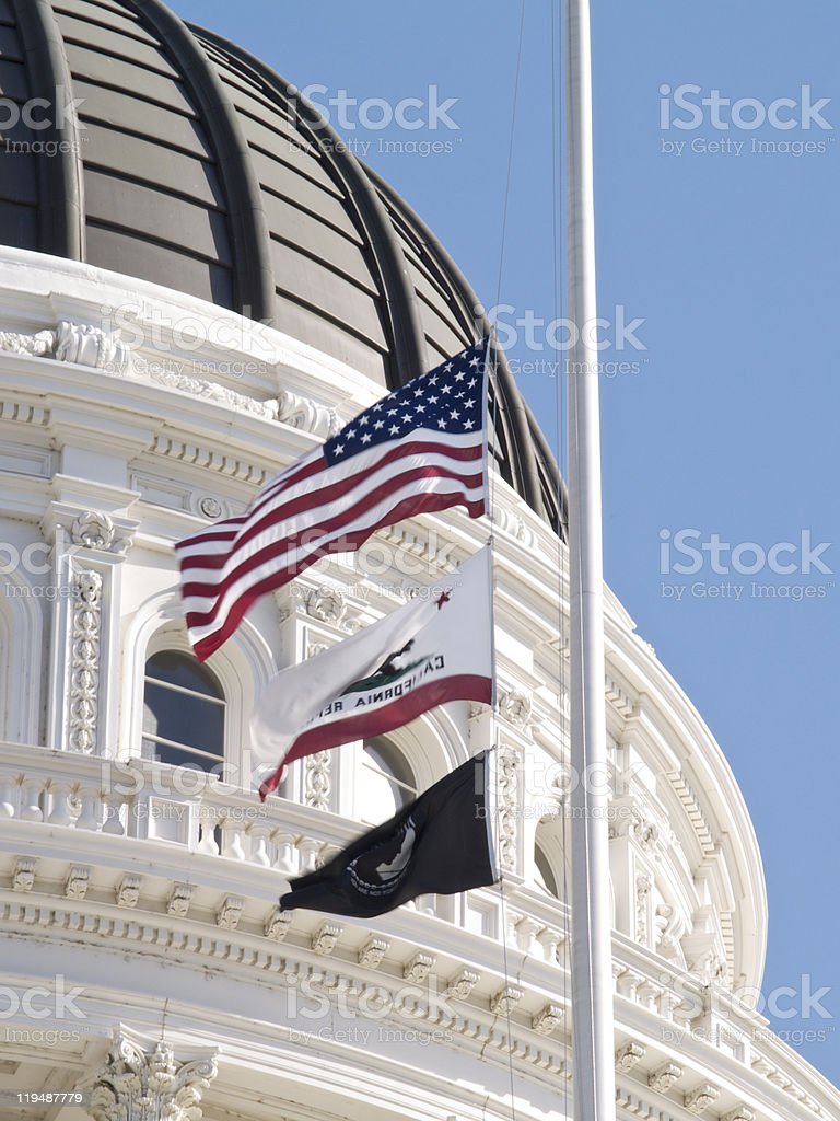 Flags Fly Over CA State Capitol stock photo