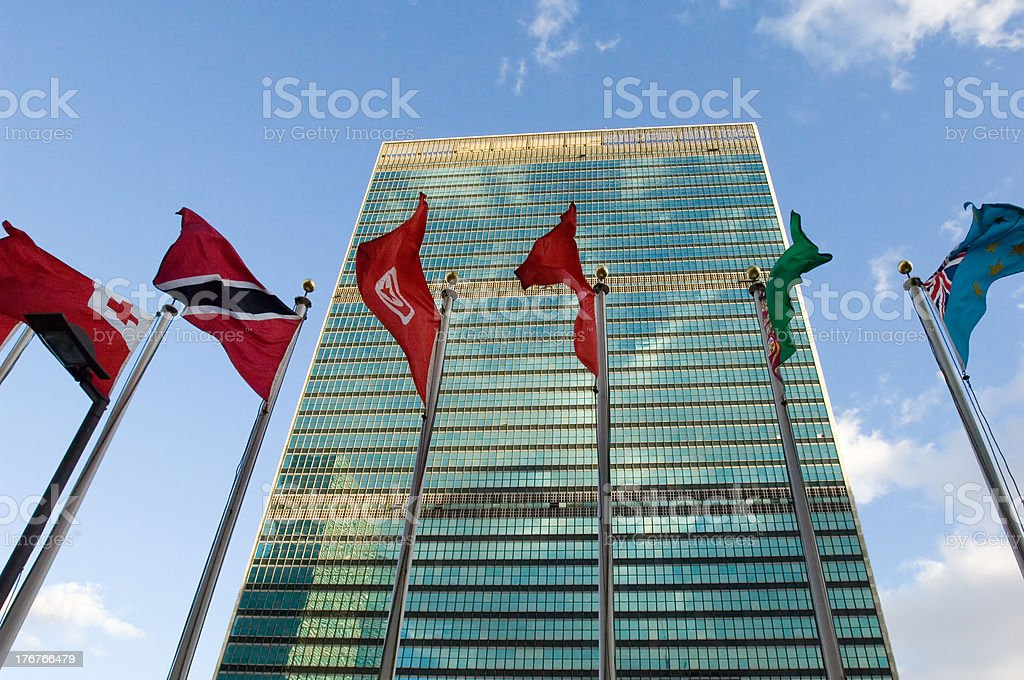 Flags flying in the wind at the United Nations building stock photo