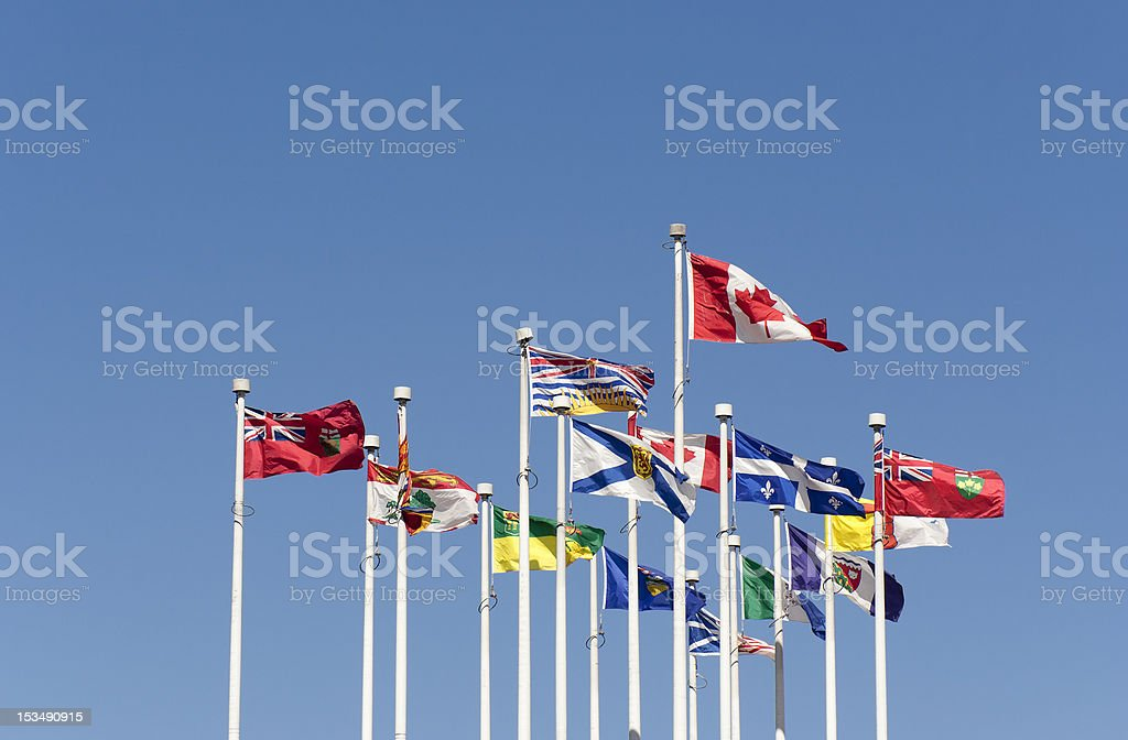 Flags flying in the Wind stock photo
