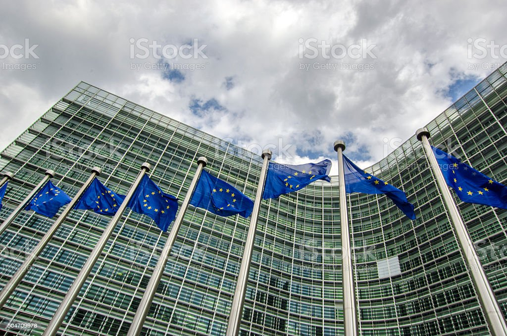 EU flags in front of European Commission in Brussels stock photo
