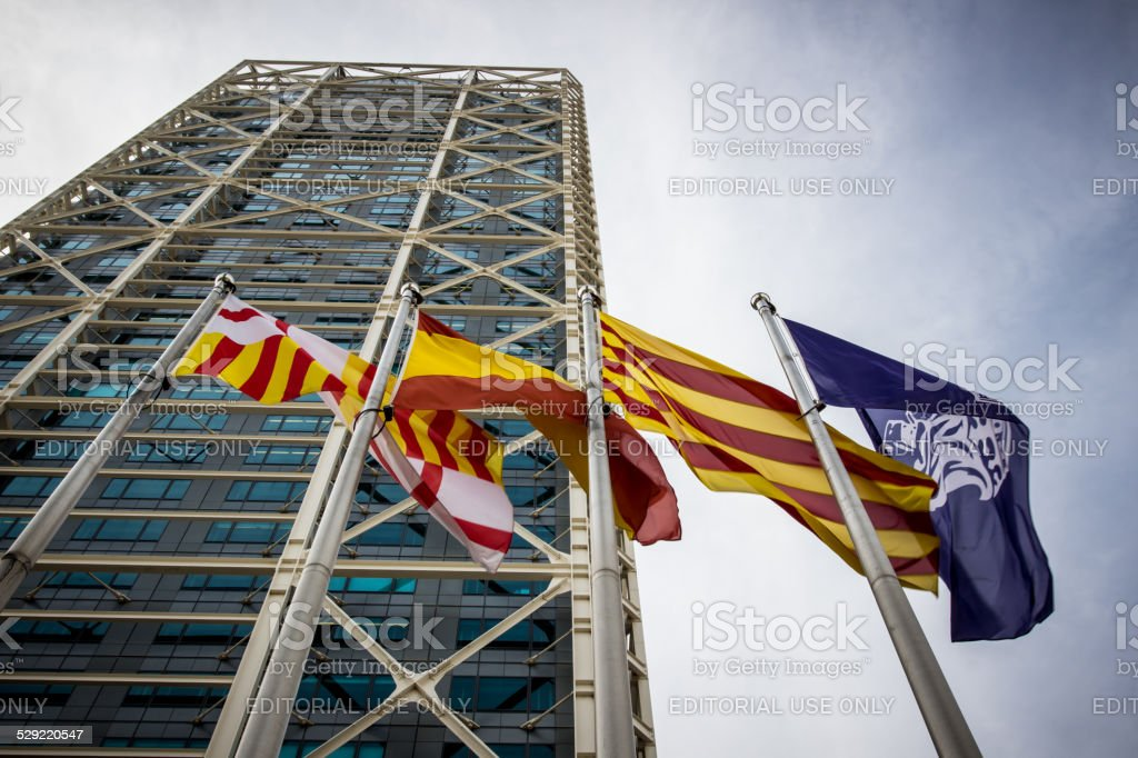 Flags in front of skyscraper stock photo