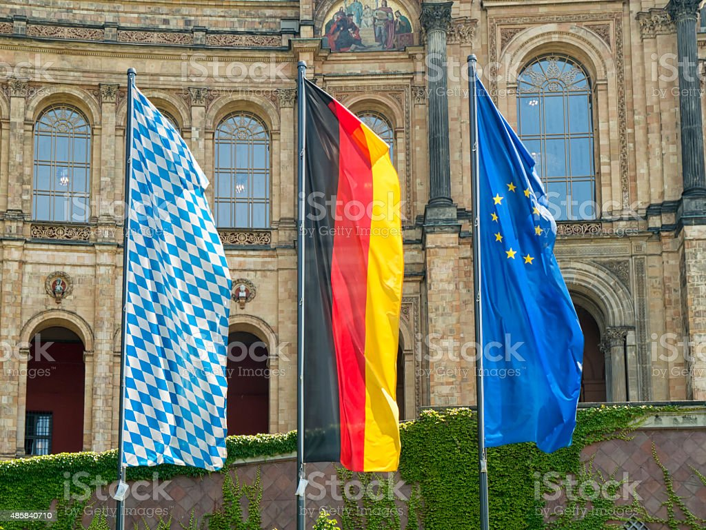 Flags in front of the bavarian state parliament stock photo