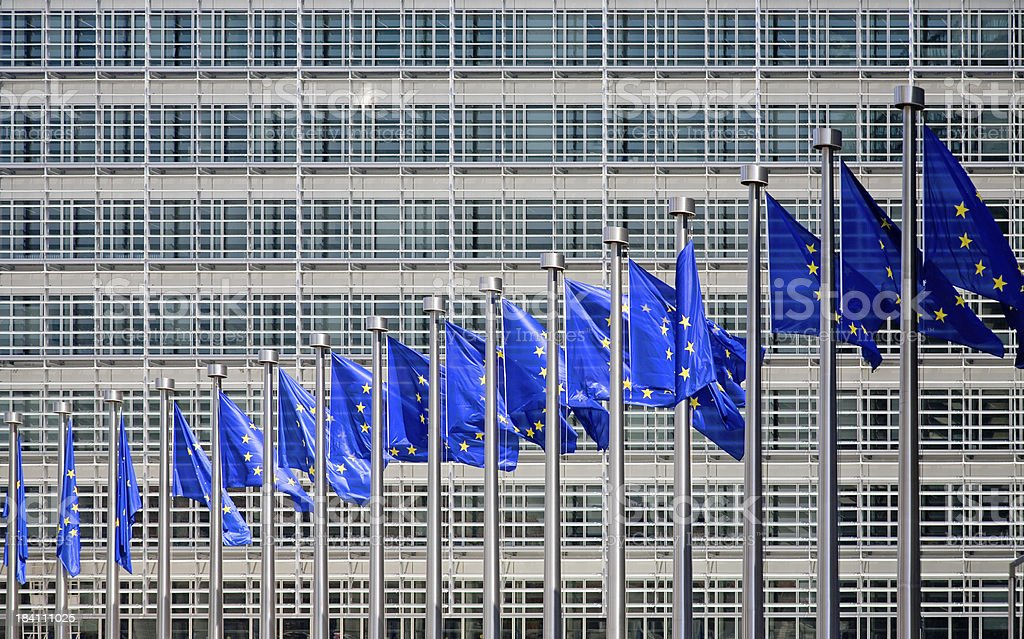 Flags in front of the European Commission stock photo