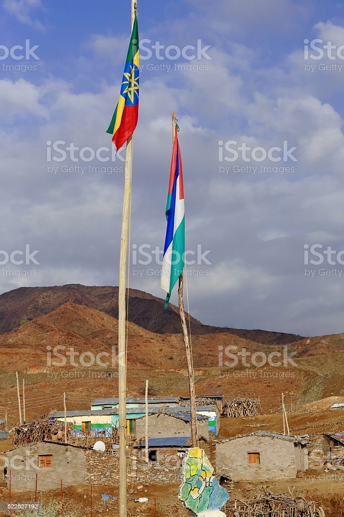 Flags in the extreme of the schoolyard. Berahile-Ethiopia. 0405 stock photo