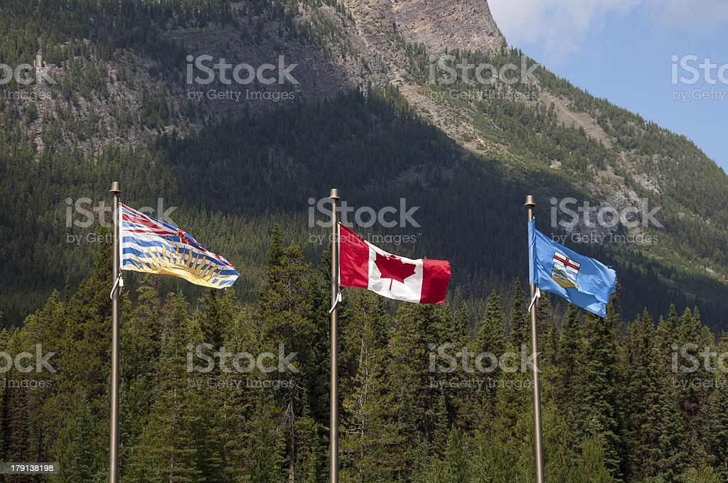 Flags of Alberta, Canada and British Columbia stock photo