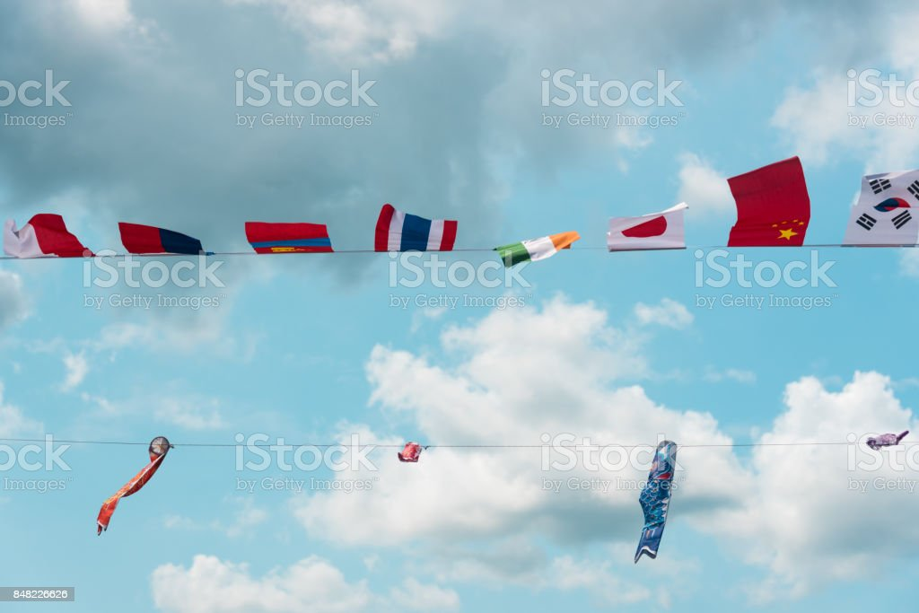Flags of all Asian countries in the park stock photo