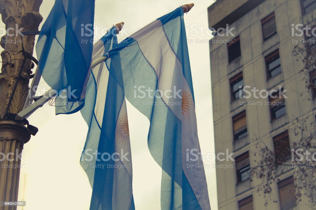 Flags of Argentina on the Plaza de Mayo, Buenos Aires, Argentina. stock photo