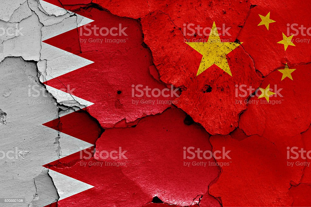 flags of Bahrain and China painted on cracked wall stock photo