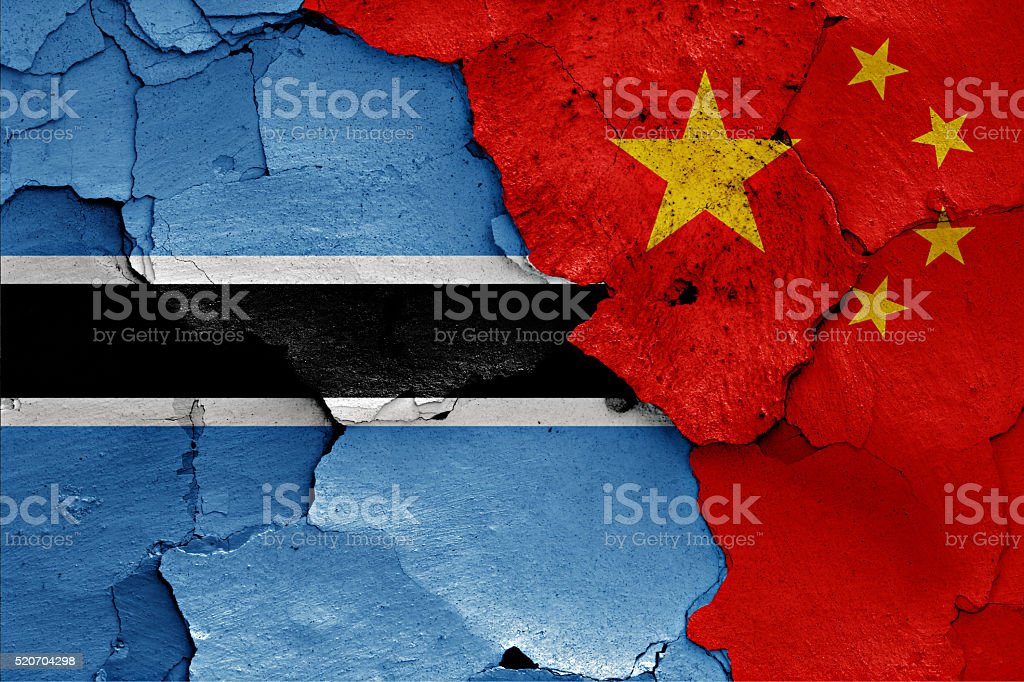 flags of Botswana and China painted on cracked wall stock photo