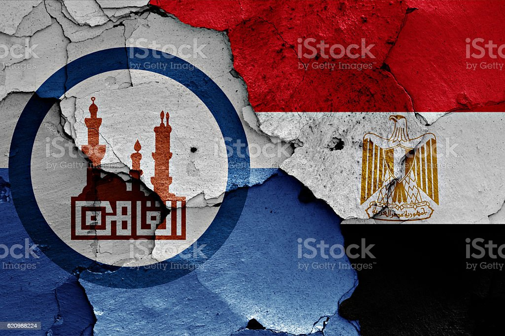 flags of Cairo and Egypt painted on cracked wall stock photo