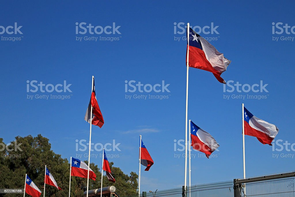 Flags of Chile on the sky stock photo