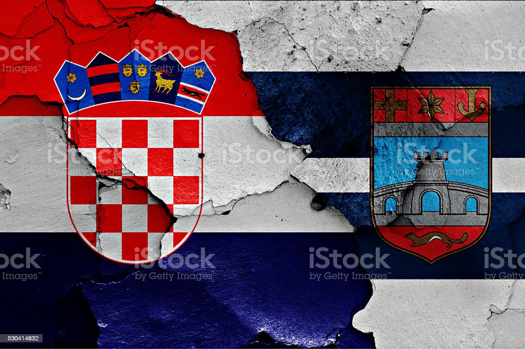 flags of Croatia and Osijek-Baranja County painted on cracked wall stock photo