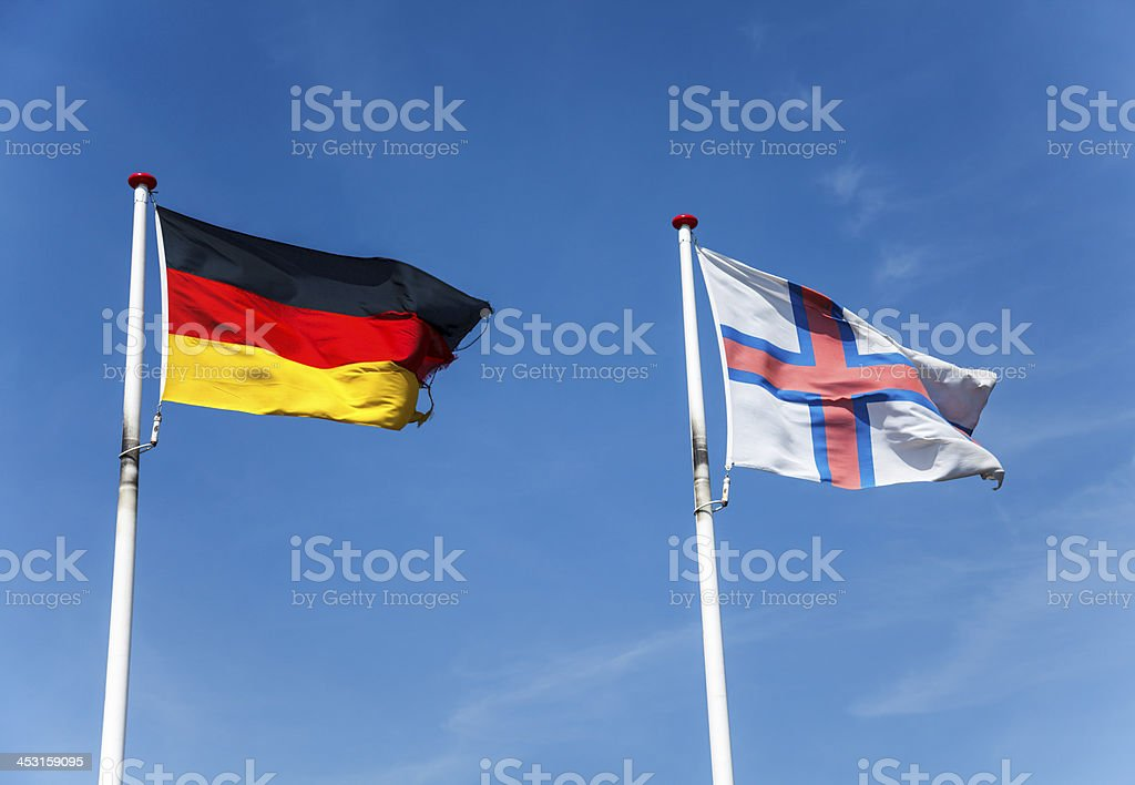 Flags of Faroe Islands and Germany royalty-free stock photo