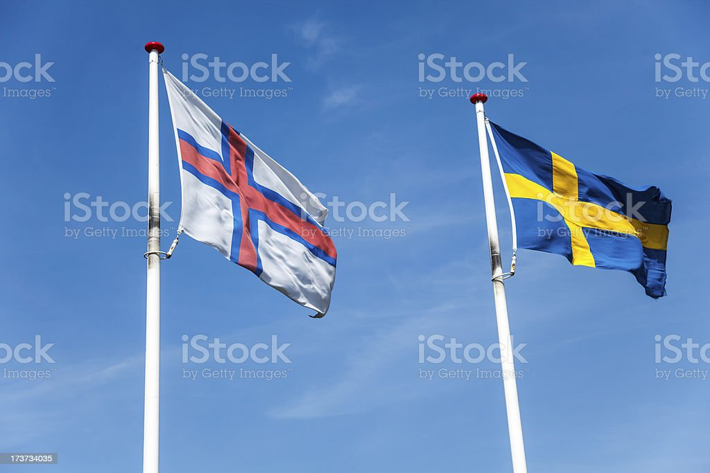 Flags of Faroe Islands and Sweden stock photo