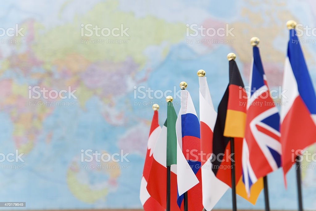 Flags of G7 countries and global map stock photo