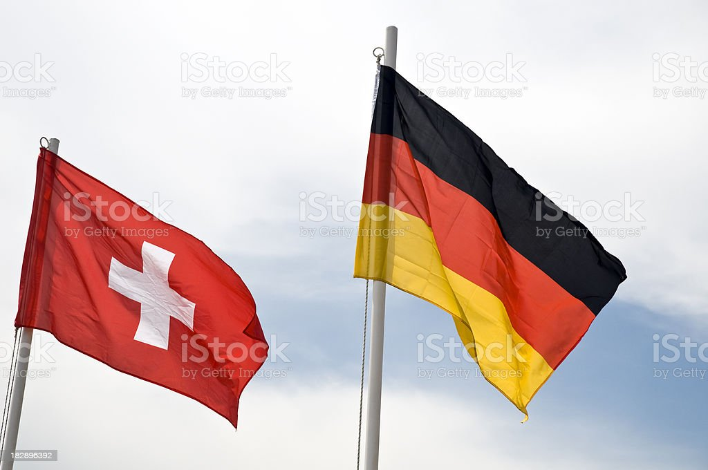 Flags of Germany and Switzerland royalty-free stock photo