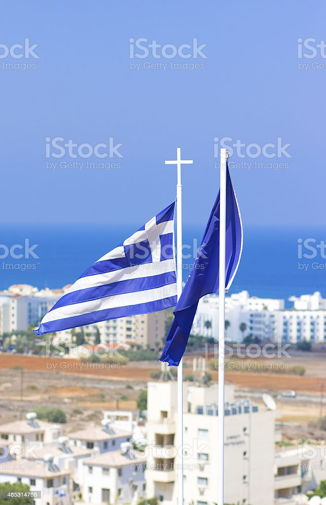Flags of Greece and European Community against white houses,sea royalty-free stock photo