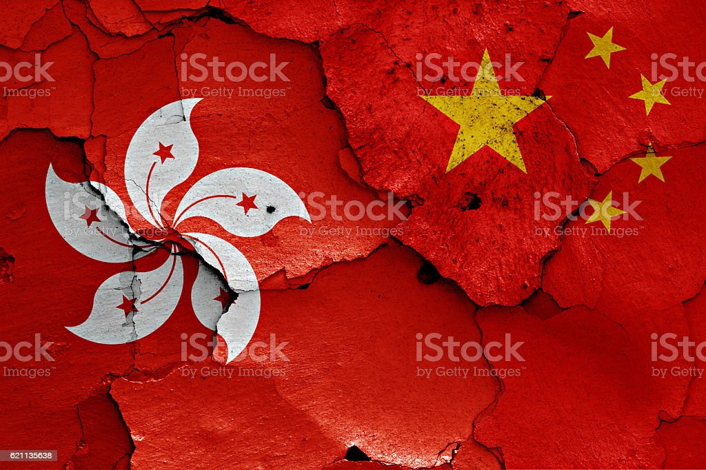 flags of Hong Kong and China painted on cracked wall stock photo