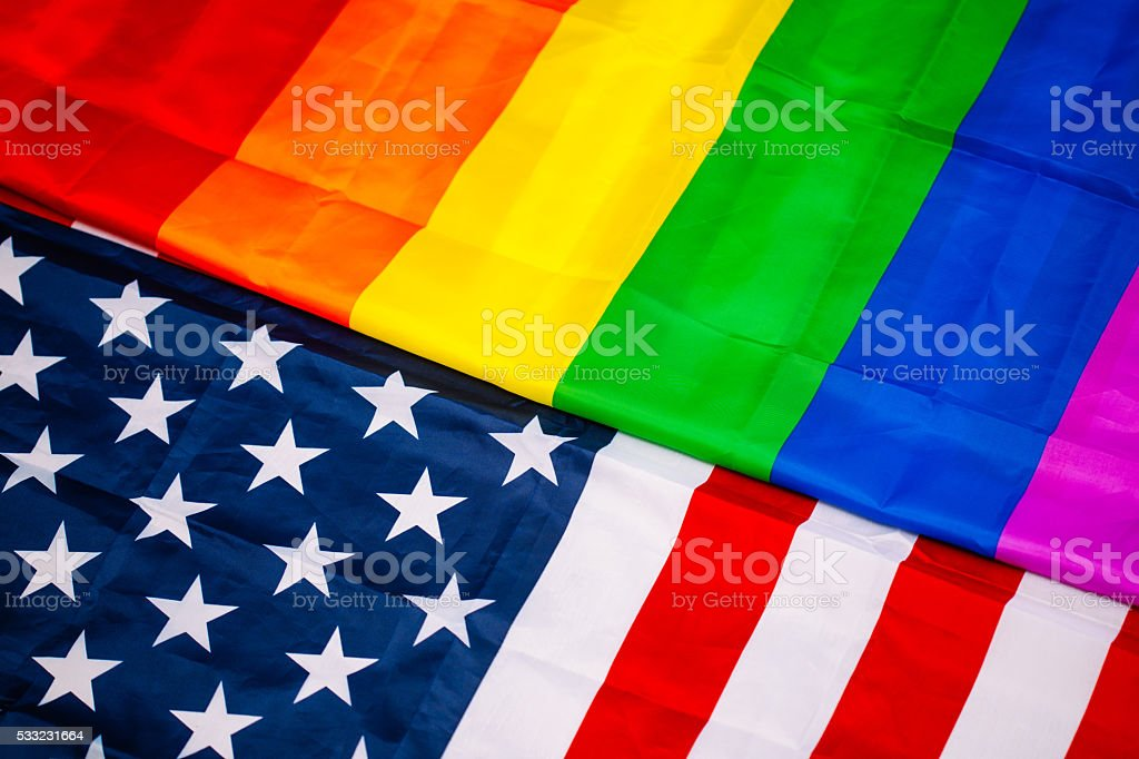 Flags of  LGBT and the USA stock photo