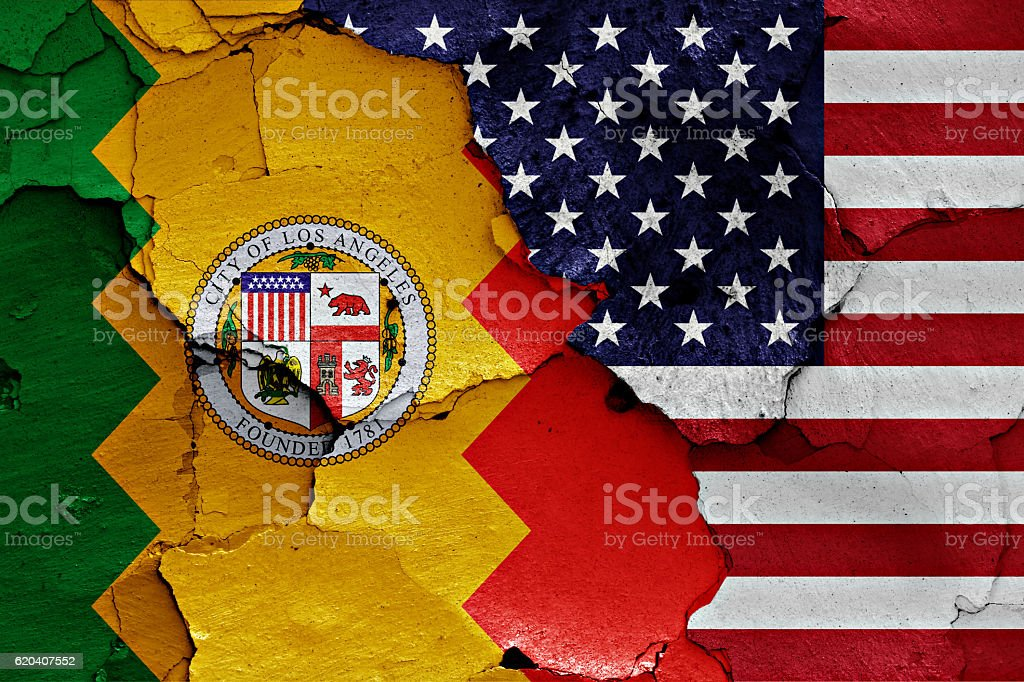 flags of Los Angeles and USA painted on cracked wall stock photo