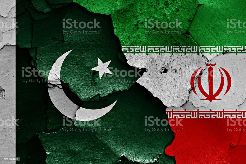 flags of Pakistan and Iran painted on cracked wall stock photo