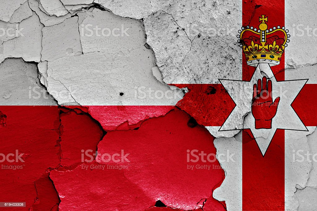 flags of Poland and Northern Ireland painted on cracked wall stock photo