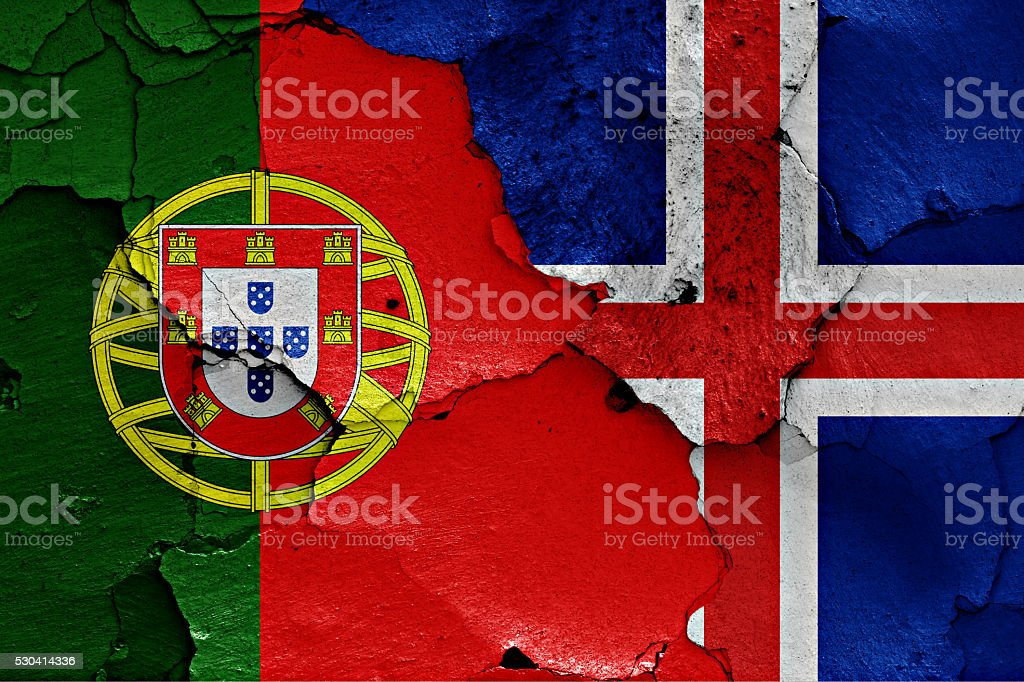 flags of Portugal and Iceland painted on cracked wall stock photo
