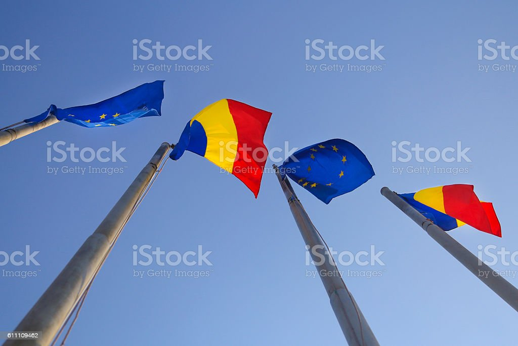 Flags of Romania and EU stock photo