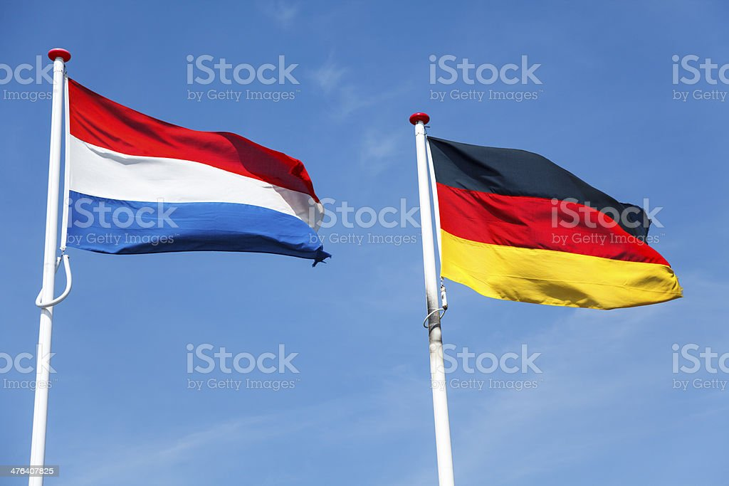 Flags of the Netherlands and Germany stock photo