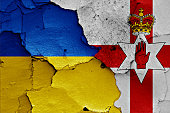 flags of Ukraine and Northern Ireland painted on cracked wall