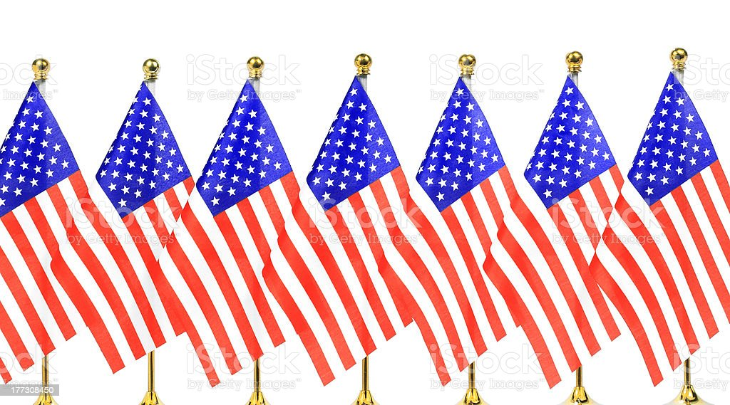 Flags of  US hanging on the gold flagpole stock photo