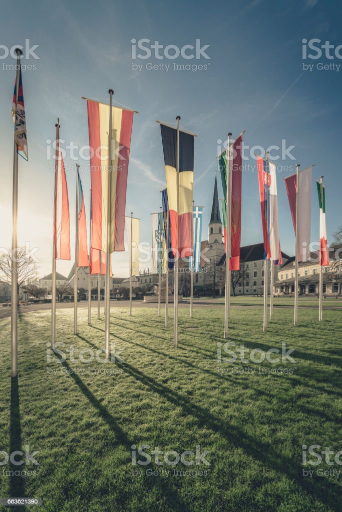 flags on Chapel Square in altoetting stock photo