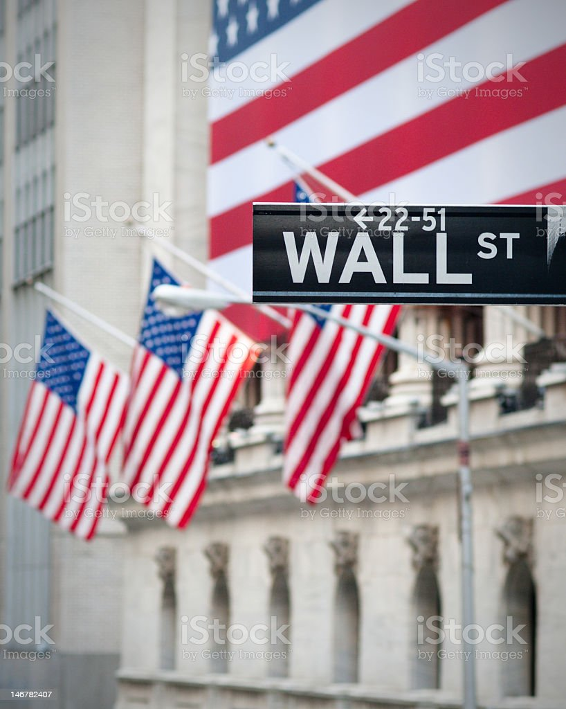 USA flags on emblematic Wall Street building stock photo