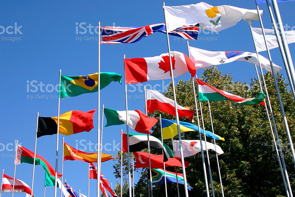 flags on flagpoles stock photo
