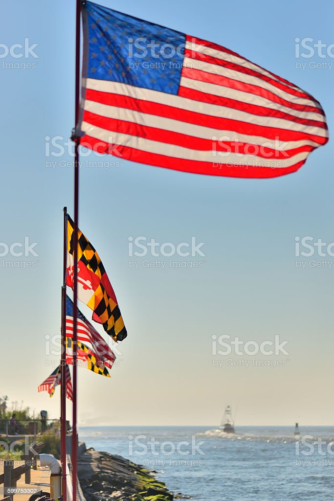 Flags on Ocean City Inlet stock photo