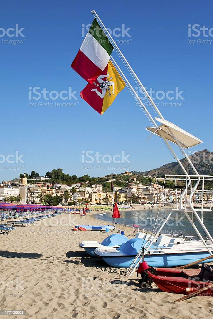 flags under beach royalty-free stock photo