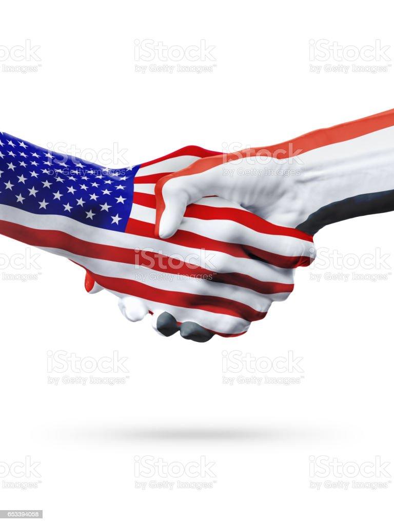 Flags United States and Iraq countries, partnership handshake. stock photo