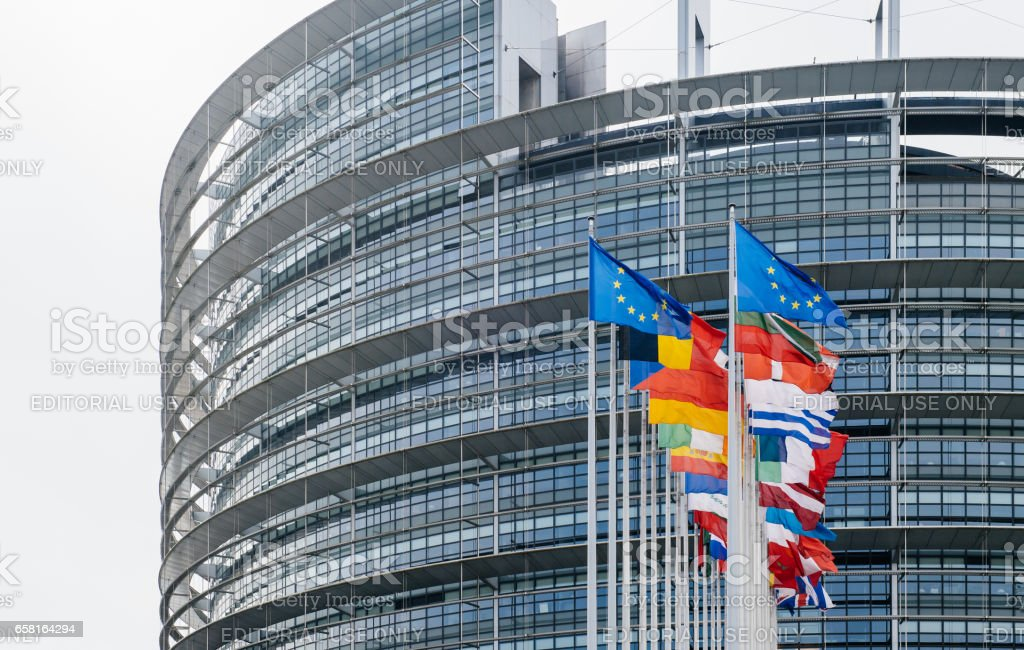 Flags waving in front of the European Parliament Strasbourg stock photo