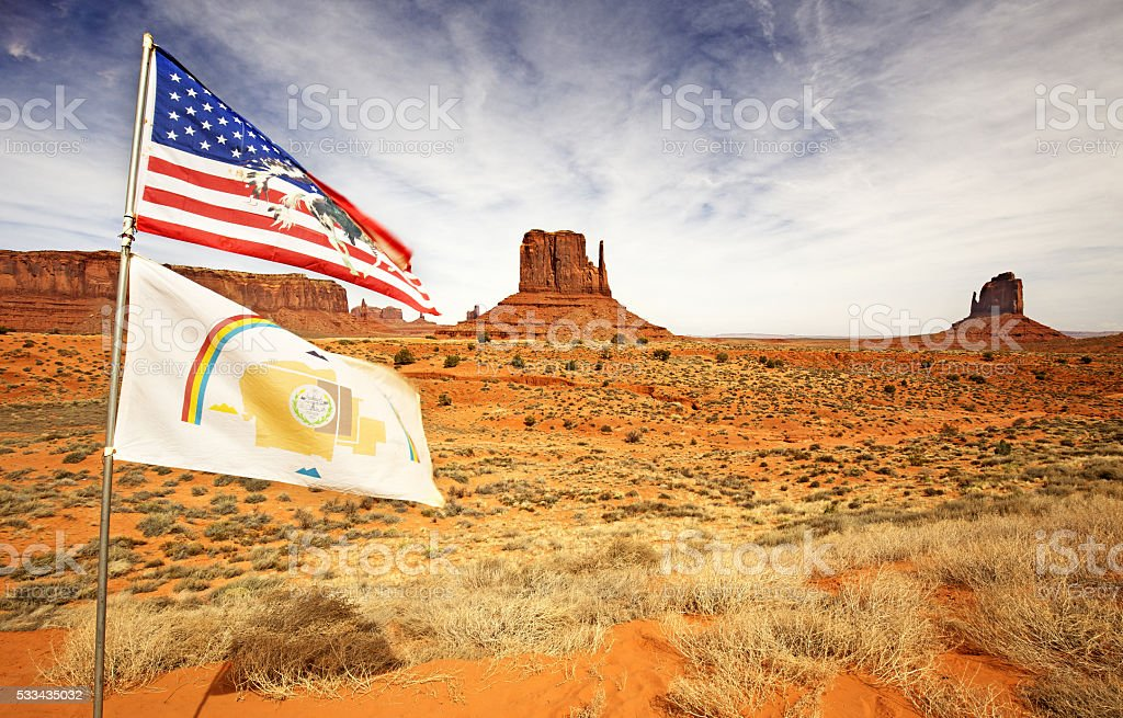 flags waving in the monument valley stock photo