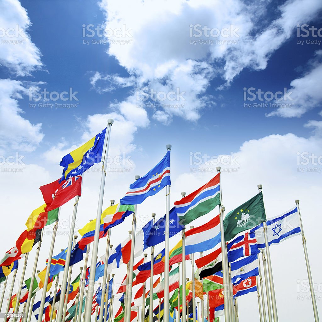flags with blue sky stock photo