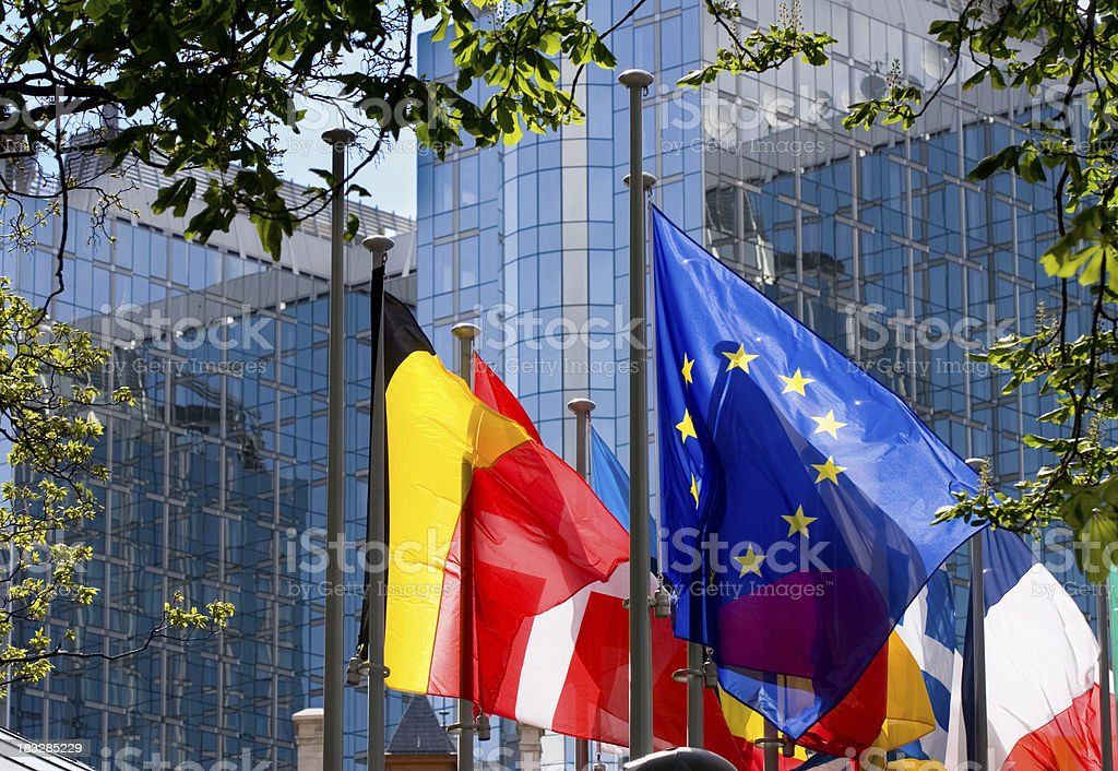 Flags with European Parliament in Brussels stock photo