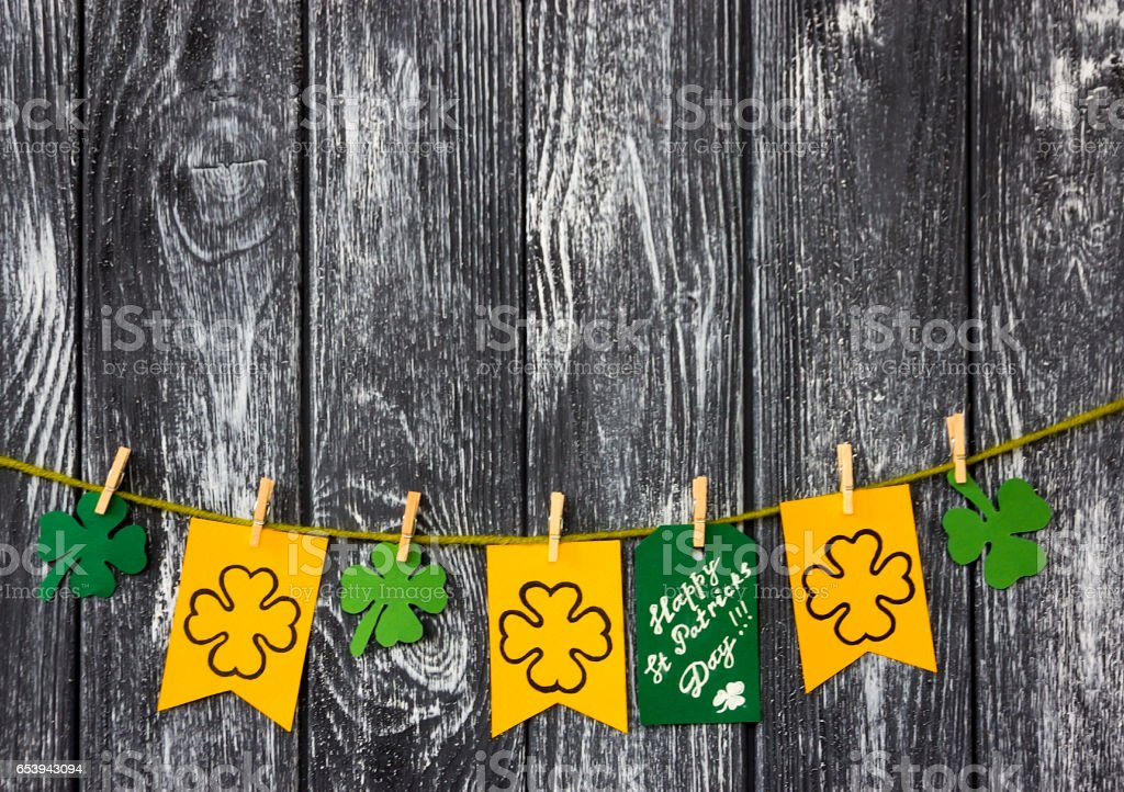 """Flags With shamrocks clover and card massage """"Happy Patricks day"""" stock photo"""
