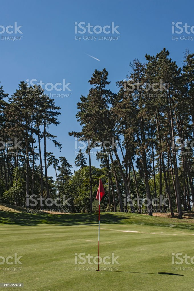 Flagstick on a golf course stock photo