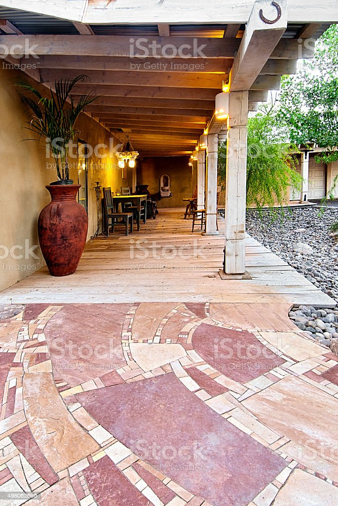 Flagstone Entrance Path and Porch with Chairs stock photo
