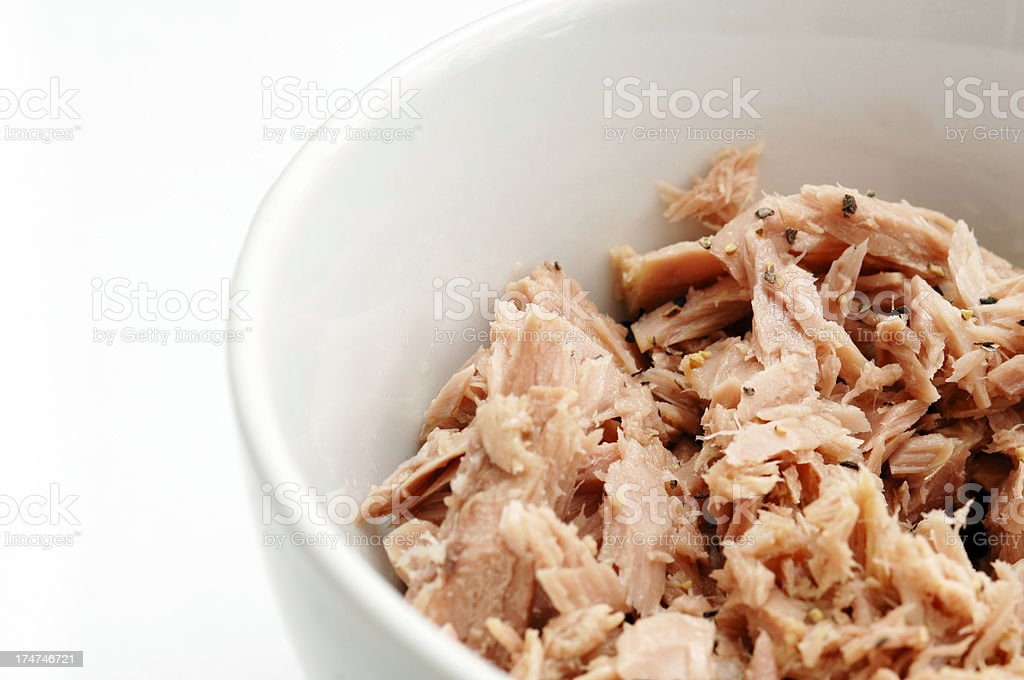 Flaked tuna fish in bowl royalty-free stock photo